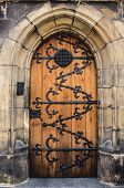 Antique Wooden Door. Wooden Door Arch. Stone Arch And Closed Door poster