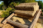 stock photo of threshing  - antique threshing stone with wood frame - JPG