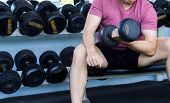 Fitness Man Doing Biceps Curl. Exercise With Sitting Dumbbell Curl At Gym. Fitness. Sport, Fitness,  poster