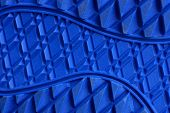 Blue Texture From A Piece Of Plastic Sole With A Pattern poster