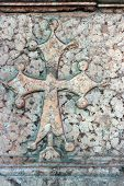 pic of maltese-cross  - Holy cross carved on a XII tomb Chiaravalle Abbey in Alseno Italy - JPG