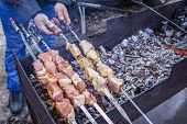 Georgian Folk Dish Kebabs. The Meat On Skewers Is Fried On Charcoal. Delicious Food On The Street. M poster