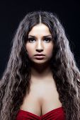 image of black curly hair  - Young beautiful serious girl with curly hair look at camera - JPG