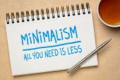 minimalism concept - all you need is less - handwriting in a sketchbook with a cup of tea, simplicit poster