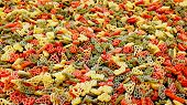 Pasta Different Colors Background. Multicolor Pasta Texture Pattern Background. Red Green Yellow Ora poster