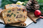 Sweet Christmas Fruit Cake Slices On Brown Paper Put On Black Granite Table In Side View Copy Space  poster