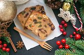 Sweet Christmas Fruit Cake Slices On White Paper Put On Black Granite Table In Top View Flat Lay Wit poster