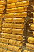 stock photo of dowry  - Gold bracelets on display at an indoor market in Istanbul Turkey - JPG
