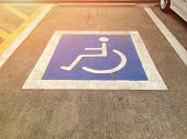 Parking For Disabled Guests At The Parking Lot. Symbol For Disabled Parking. Wheelchairs Symbol. poster