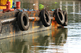 image of coal barge  - Side Details of a Barge Boat in Calm Water - JPG