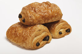 image of doughy  - two times croissant with chocolate close up