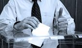 foto of election campaign  - Hand putting a blank ballot inside the box elections concept BLUE TONE - JPG