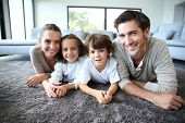 picture of daddy  - Family at home relaxing on carpet - JPG