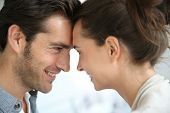 stock photo of forehead  - Profile of loving couple looking at each other - JPG