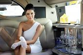 picture of limousine  - Beautiful smart woman sitting in limousine - JPG