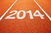 foto of new year 2014  - Number 2014 on athletics all weather running track - JPG