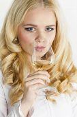 portrait of young woman drinking white wine