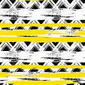 stock photo of primitive  - Vector seamless ethnic pattern with bold zigzag brushstrokes and stripes in bright colors can be used for print - JPG