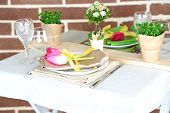 Beautiful spring table setting on bright background