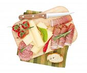 Cheese, prosciutto, bread, vegetables and spices. Isolated on white background