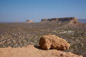 foto of arid  - Arid landscape of flat topped mountains set amongst the vast plains of Damaraland in Namibia  - JPG
