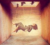 a woman being carried by birds in a box done with a warm instagram like filter