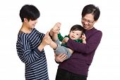 Happy asia family playing with baby boy
