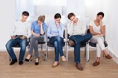 foto of boring  - Young Group Of People Sleeping On Chair In A Waiting Room - JPG