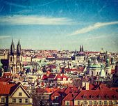 Vintage retro hipster style travel image of aerial view of Prague, Czech Republic with grunge textur