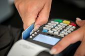 image of debit card  - Debit card swiping on pos terminal - JPG