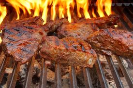 foto of braai  - Beef Steak on the BBQ Grill with flames - JPG