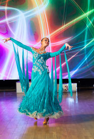 foto of waltzing  - Female dancer performs at dance championship - JPG