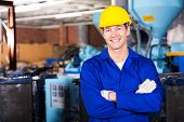 picture of blue-collar-worker  - good looking blue collar worker in factory - JPG