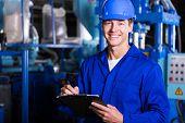 image of factory-worker  - male industrial technician working inside a factory - JPG