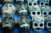 pic of mexican fiesta  - Traditional mexican day of the dead souvenir ceramic skulls at market stall - JPG