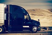 foto of semi  - Speeding Dark Blue Semi Truck in Nevada United States - JPG