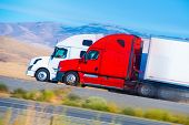 stock photo of tractor trailer  - Two Speeding Semi Trucks on the Nevada Highway USA - JPG