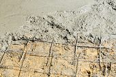 pic of concrete pouring  - Close up wire mesh and wet cement in concrete floor pouring process - JPG