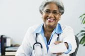 image of prescription  - African female doctor holding a prescription - JPG