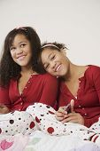 pic of identical twin girls  - African twin sisters hugging - JPG