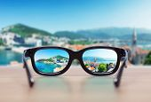stock photo of protective eyewear  - Cityscape focused in glasses lenses - JPG