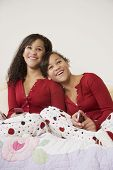 picture of identical twin girls  - African twin sisters hugging - JPG