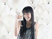 foto of pacific islander ethnicity  - Pacific Islander woman drinking champagne - JPG