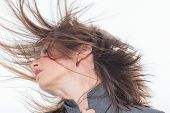 stock photo of hair motion  - Woman face with hair motion  close up portrait - JPG