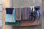 pic of wet pants  - Laundry is hung at clothes line to dry in Italy - JPG
