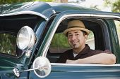 stock photo of 35 to 40 year olds  - Hispanic man sitting in truck - JPG