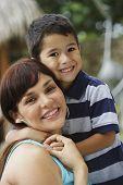 stock photo of adoration  - Hispanic mother and son hugging - JPG