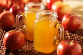 stock photo of mason  - mason jars filled with hot apple cider - JPG