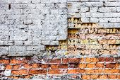 pic of mortar-joint  - The old damaged brick wall with rich texture - JPG