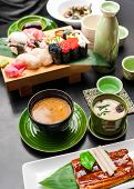picture of exotic_food  - Premium quality grilled eel miso soup sake and sushi rolls served in Japanese restaurant. Asian food background